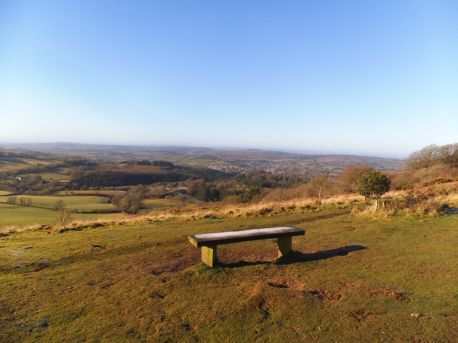 Sit for a while and take in spectacular views over the countryside to the sea.